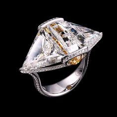 A white gold and diamond ring by Forms Jewellery.
