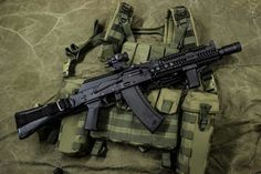 AK105 with Magpul pistol grip, BCM vertical grip, zenitco upper and lower handguard, Bulgarian flash hider, and an Aimpoint T2 red dot sight.