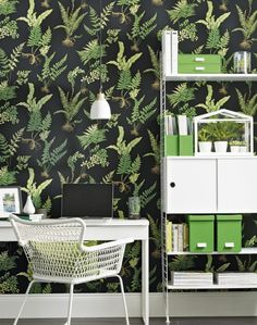 A freestanding bookcase and storage unit create ample space for office must-haves