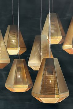 CELL is a light that mimics cellular growth and can be used in multiple geometric configurations. Made from layers of minutely etched, polished brass, Cell Pendant Short and Wall Light use a Crown Brass LED lamp exclusively developed with Megaman.