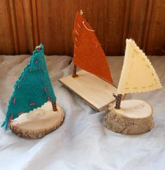 Simple boats from rounds of wood, a twig for a mast, and a felt sail... might turn into a fleet of pirate ships!