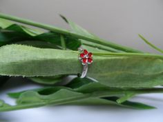 A personal favorite from my Etsy shop https://www.etsy.com/listing/244876961/childs-adjustable-red-flower-ring-kids