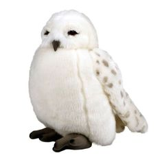 This reproduction of Hedwig is a white puppet plush featuring a movable head and a button which activates owl noise sound effects. Puppet stands 9 1/2 inches tall. Button on wing activate owl noise