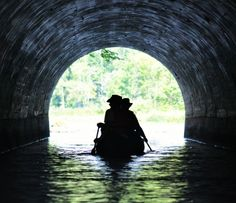 Paddling through a tunnel out of the Seguin River and into Portage Lake in McDougall, Ontario. Photo by Josh Schwindt