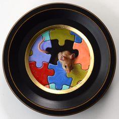 """A special mouse for World Autism Awareness Day. Une souris spéciale pour la journée mondiale de sensibilisation à l'autisme. Oil painting, 4"""" diameter. Huile, 10cm de diamètre."""