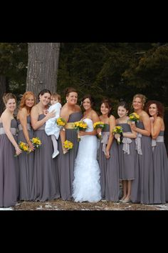 Bridesmaids wearing Alfred Angelo 7017 chiffon dresses. Charcoal with light gray sashes... Maid of Honor in charcoal with a light yellow sash. Bridal dress is a Casablanca 2096 with a sewn in beaded flower sash.