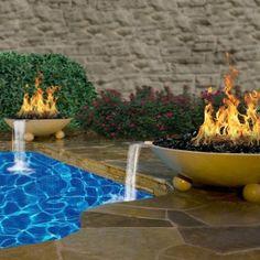 Wet pools inc plaster wet edge luna quartz aruba for Fire features for swimming pools