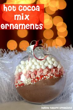 Start with a clean ornament and take the top off. Fill each ingredient into the ornament using a funnel. Start with the hot cocoa mix, then sprinkles, then chocolates and then the mallow bits. Put top back on. You will need to deliver these standing upright or wrap the top with plastic wrap to keep contents inside. It's ready to go.