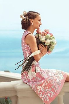 pink brocade dress with fresh rose bouquet
