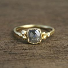 Gorgeous simple MOONSTONE RING on a delicate gold band.  Lightly textured 18ky gold with small diamonds.