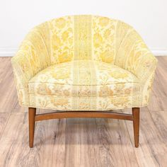 This mid century modern barrel chair is upholstered in a durable cream and yellow green floral print fabric. This armchair is in good condition with a curved back, tapered legs and solid maple wood base. Stylish and comfortable seat with a matching chair! #midcenturymodern #chairs #accentchair #sandiegovintage #vintagefurniture