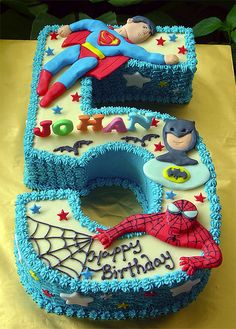 Superhero cake - love this idea with the number.