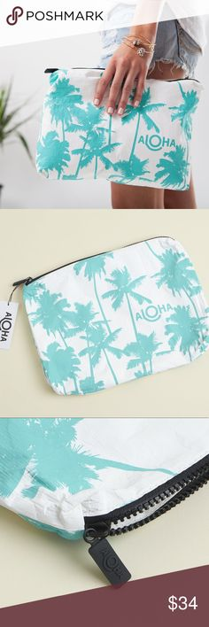 "NWT 🆕 Aloha Large Pouch Summer Clutch Beach Swim Brand new with tags in plastic. Never used. Aloha collection mid-sized pouch from popsugar. Perfect to put in your bag to keep wet things separated. This pouch is perfect to use as a beach clutch.  Stow your sunscreen, sarong, & bikini, or pack toiletries for your next trip! This white/teal print was inspired by Kauai's coco palms & the Coco Palms Resort. Material is 100% coated Tyvek, splash proof.  Pouch measures:  11.5"" across x 2"" wide x…"