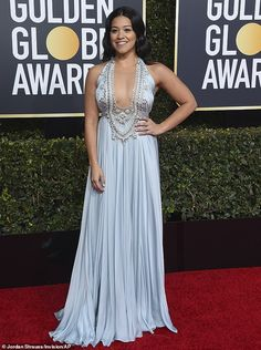 Feeling blue  Gina Rodriguez wore a long blue Reem Acra gown on Sunday at  the a49bb41e6