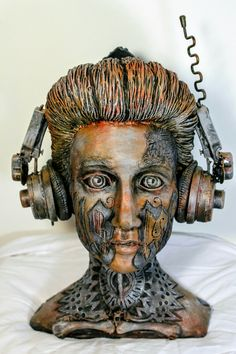 Tattooed music portrait. An assemblage made from water based clay and found objects. It is inspired by the tattoos of Lesya Toumaniantz.