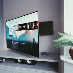 Clever and neat way to mount and hide your tech. Tv Set Up, Sims 4 City Living, Hidden Games, Living Room Setup, Mundo Dos Games, Video Game Rooms, Gamer Room, Gaming Setup, Xbox