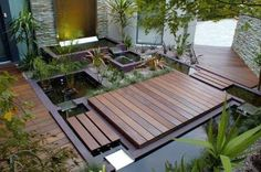 small japanese garden design ideas with pond and wooden deck