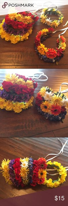 Handmade flower crowns/ headbands Beautiful flower crowns perfect for the upcoming seasons! They are sure to bring out the flower child in everyone who wears them. I used to sell these at boutiques and take orders for parties, these have never been used. If you are interested in CUSTOM ORDERS just ask! I will make listings just for you, any flowers or colors! Prices vary for custom orders! Some have ribbons in the back to hang down with your long locks or for a small tie. Perfect for…