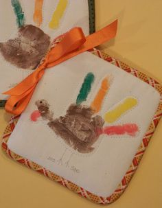 handprint turkey potholder Use a solid color store-bought potholder and make the handprint on it.