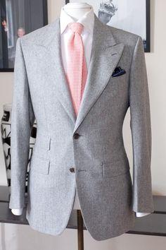 Grey suit, pink tie, navy pocket square!!! Love!