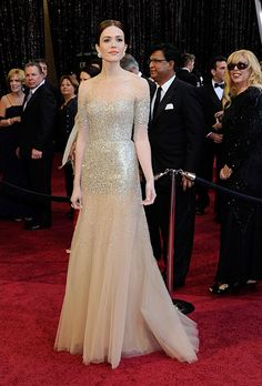 Brides.com: The Most Wedding-Worthy Red Carpet Dresses. Mandy Moore at the 2011 Oscars. Moore looks like a live version of the Oscar statuette in her glittering gold Monique Lhuillier gown. It's no coincidence that she also looks completely bridal—the gown was also designed in white as part of Monique Lhuillier's Spring 2011 bridal collection.  Browse Monique Lhuillier wedding dresses.