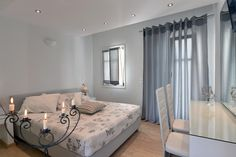 Alexandros Apartments    Alexandros Apartments is a stylish complex built in traditional Cycladic style. It overlooks Piperi Beach, and is 5 minutes' walk from the centre of Naoussa and its picturesque harbour.