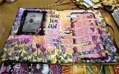 Dyan Reavely art journals at Creative Displays at CHA