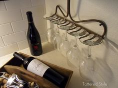 Take the handle off an old rake and turn it into a wineglass rack.