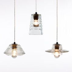 Light and airy, these Pressed Glass Pendants from Tom Dixon have a raw look of the recycled glass. http://www.ylighting.com/blog/industrial-modern-lighting/