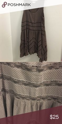 Free People Lace & Voile trapeze tank slip. Large NWOT. Brown/Fawn color. Tag has cut. No flaws Free People Tops Tank Tops