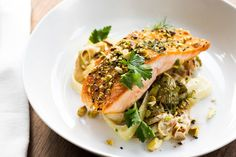 Dukkah-Spiced Salmon with Spring Vegetable & Oyster Mushroom Ragout. Visit https://www.blueapron.com/ to receive the ingredients.