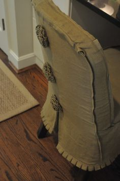 Nine & Sixteen: Our Weekend | Great Friends + Good Food + Pretty Homes.  slipcover w/rosettes and box pleats