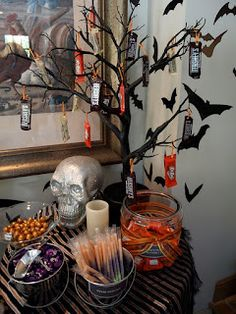 halloween candy bar- I love the tree with candy and bats hanging from it