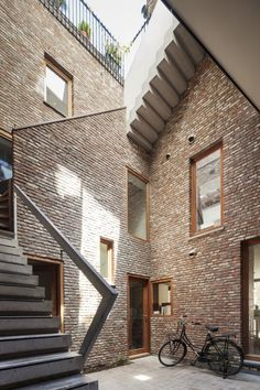 Gewad apartment building by Atelier Vens Vanbelle in Ghent, 2012. Mirrors bring light to the narrow courtyard.