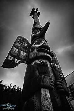 A carved totem pole that sits in downtown Ketchikan Alaska, Alaska is filled with Alaska Native People who have been doing things like carving totem poles for many...many hundreds of years