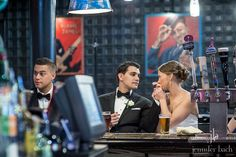 The bride and groom enjoy a beer before their reception