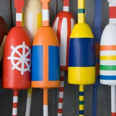 it might be fun to paint some life into some old buoys (easy summer backyard decor)