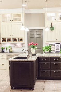 The Pool Family Kitchen  by Dear Lillie....cubbies under cabinet = fab