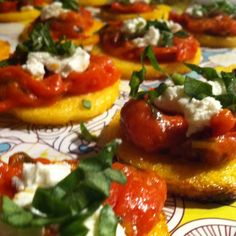 Broiled polenta circles topped with home made tomato sauce, goat cheese and fresh basil. Gluten Free Treats for bunco tonight!