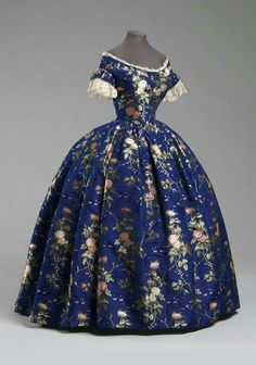 1850 evening dress, this dress seems to be made out of silk with multiple layers…