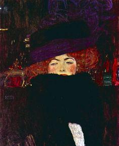 signora con cappello e boa di piume