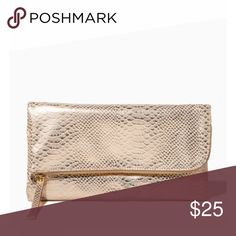 NWT Gold Foldover Clutch 💎👛 💎Fun meets functional in this soft faux leather clutch that unfolds into a zippered pouch for added storage finished with a removable studded tassel accent. NWT Boutique Brand Bags Clutches & Wristlets