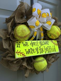 """If We Don't Answer We're At The Ballfield Softball Burlap Wreath Burlap ruffled wreath on a 14"""" frame with real used softballs. Custom made sign with any wording you would like. Signs are painted on reclaimed wood so there may be imperfections or slight differences from what is shown but it just adds uniqueness and character to your wreath. Age and cleanliness of softballs will vary as they are all used and well loved. Some may have some writing and markings on them but I will do my best to not  Softball Wreath, Softball Room, Softball Party, Softball Bags, Softball Cheers, Softball Crafts, Softball Pitching, Softball Quotes, Softball Shirts"""