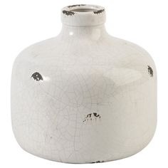 Perfect as a simple accent or for displaying an arrangement of lush blooms, this ceramic vase showcases a vintage-inspired crackle finish in white.