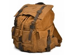 - * Premium quality Canvas Leather Hiking Outdoor backpack for men and women. - * Double shoulder straps with short handle. - * Rucksack style. - * Interior zip, wall and cell phone pockets - * Exteri