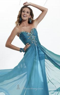 Stand out from the rest on your special night in Tiffany Designs 16757. A beautiful flowing evening gown in chiffon. The ruched fitted bodice is strapless and has a sweetheart neckline. Beads and rhinestones embellished the bodice to add the perfect touch of sparkle.