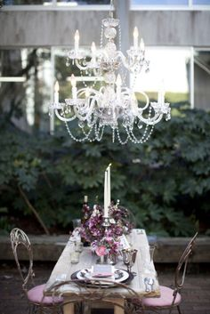 anywhere can be turned into the setting for an elegant dinner party: just add a chandelier ;)