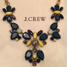 NWOT J.Crew Chunky Stone Necklace Given to me as a gift but never worn! Necklace features teal, marine blue, and neon yellow stones mixed with smoky gray rhinestones. Necklace itself is burnished gold like most J.Crew costume jewelry. Comes with J.Crew jewelry pouch. Would look great with crisp white, pale gray, and navy. No trades please. J. Crew Jewelry Necklaces