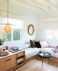 built-in benches with white cushions. / sfgirlbybay