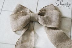 From Shanty-2-chic.com ... TUTORIAL for burlap-bow Christmas Tree topper.